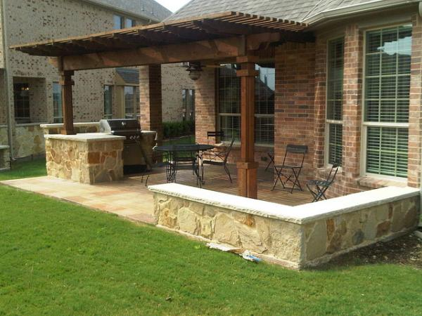 Houston outdoor kitchen with cedar pergola lone star for Backyard kitchen design ideas