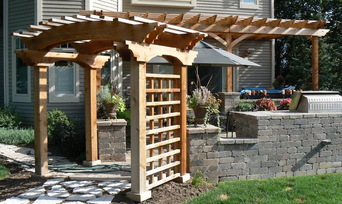 Arched Cedar Pergola With Attached In Background