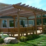 Wood Pergola With Bench Seating and A Deck in Katy TX